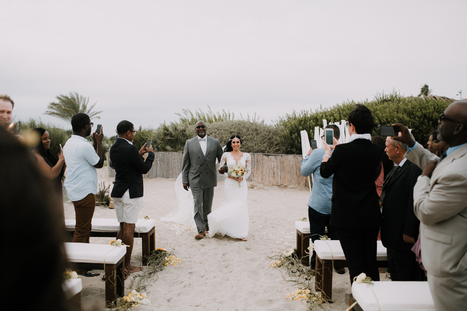 bride arriving to the beach ceremony