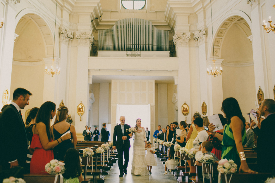 Bride and father walking into the church